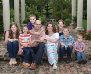 Jade Stanford and his wife, Jennifer, surrounded by their six children.